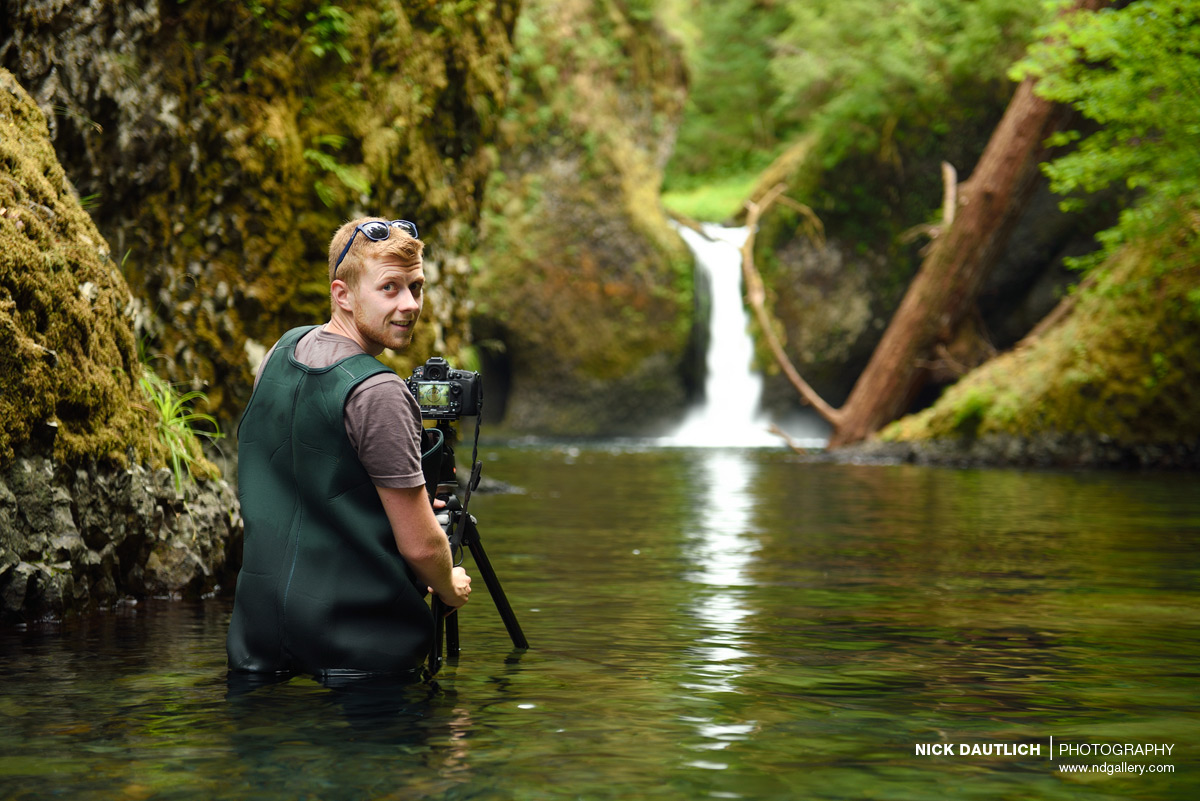 Photographer wearing waders
